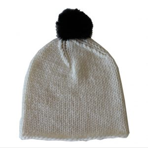 white beanie with pom pom