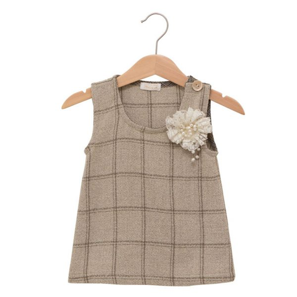 Wool dress with a lace brooch